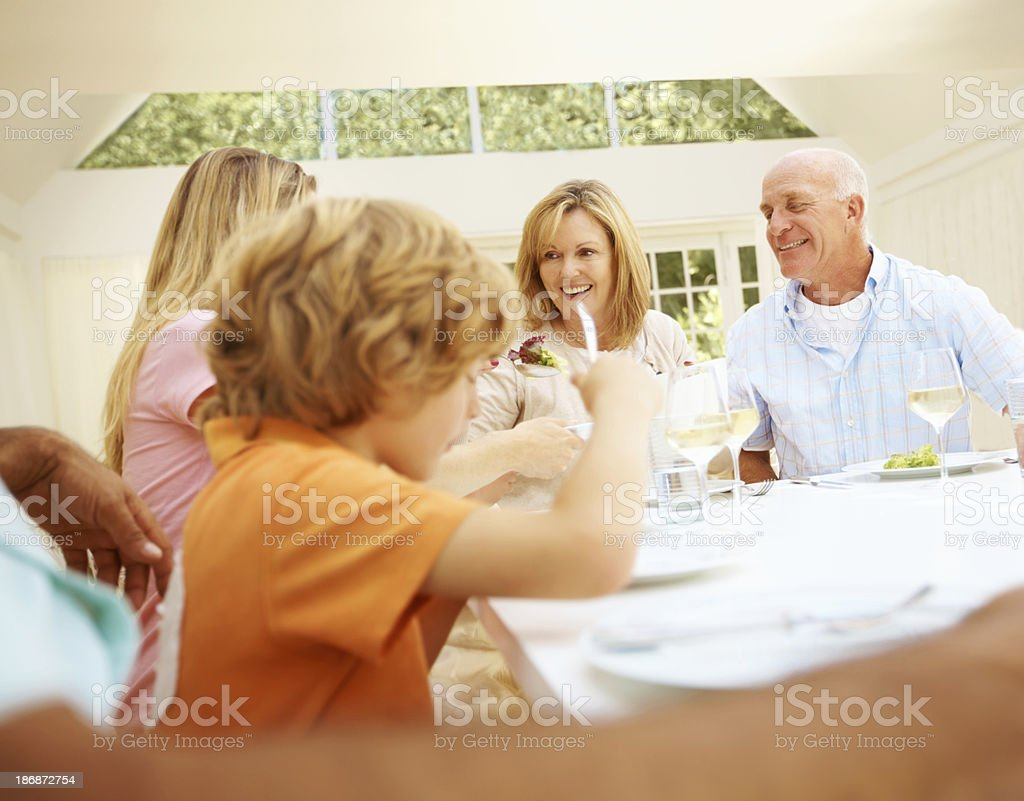 Tucking in to a family feast royalty-free stock photo