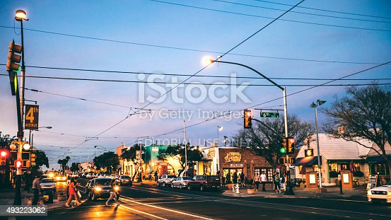 Tucson, AZ, USA - February 16, 2014: People crossing the street on 4th Avenue. 4th Avenue avenue is popular shopping, dining and drinking place.