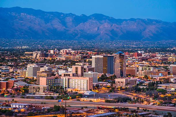Tucson Arizona skyline cityscape and Santa Catalina Mountains at dusk Tucson Arizona skyline and Santa Catalina Mountains at dusk. tucson stock pictures, royalty-free photos & images