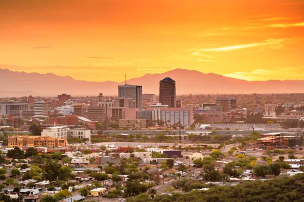 Tucson, Arizona, USA Skyline Tucson, Arizona, USA downtown city skyline with mountains at twilight. tucson stock pictures, royalty-free photos & images