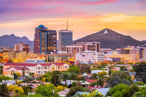 Tucson, Arizona, USA downtown skyline with Sentinel Peak at dusk. (Mountaintop