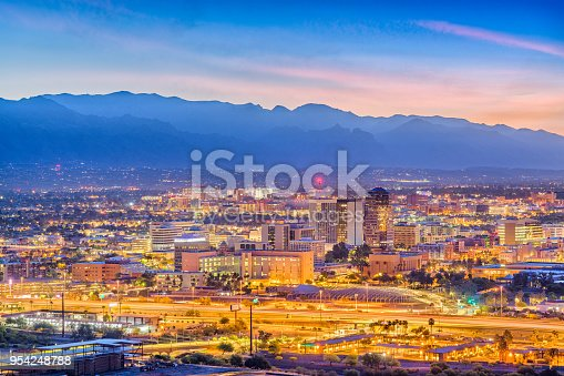Tucson, Arizona, USA downtown skyline from Sentinel Peak at dawn.