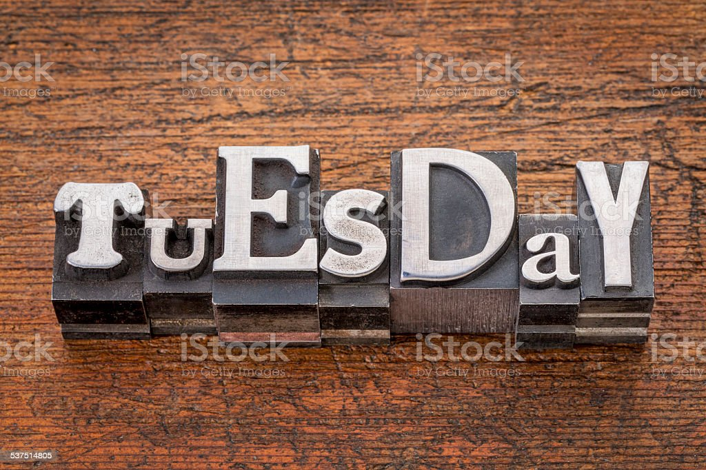Tuesday word in metal type stock photo