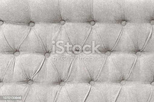 Upholstery background - tufted fabric of bed headboard