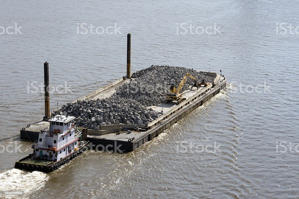 Tug and barge with stone royalty-free stock photo