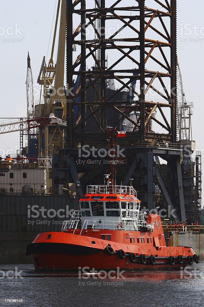 Tug and platform leg royalty-free stock photo
