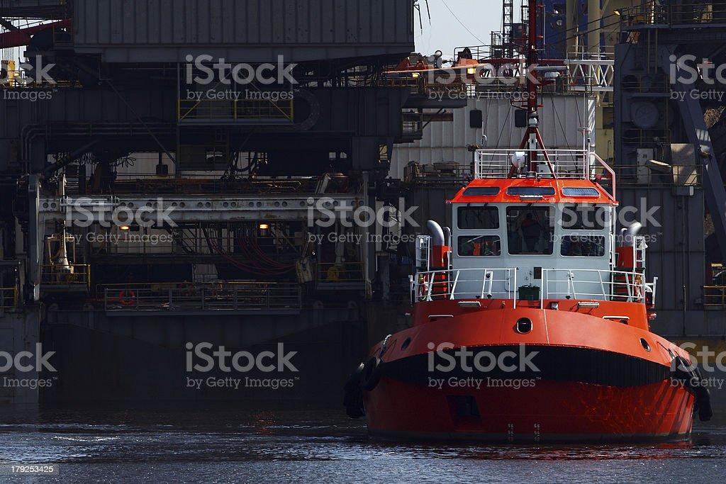 Tug and platform royalty-free stock photo