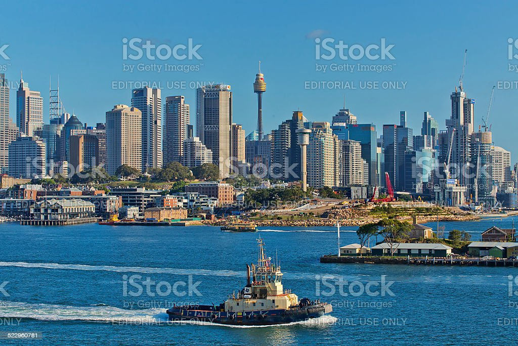 Tug boat and skyscrapers in Sydney Harbour stock photo