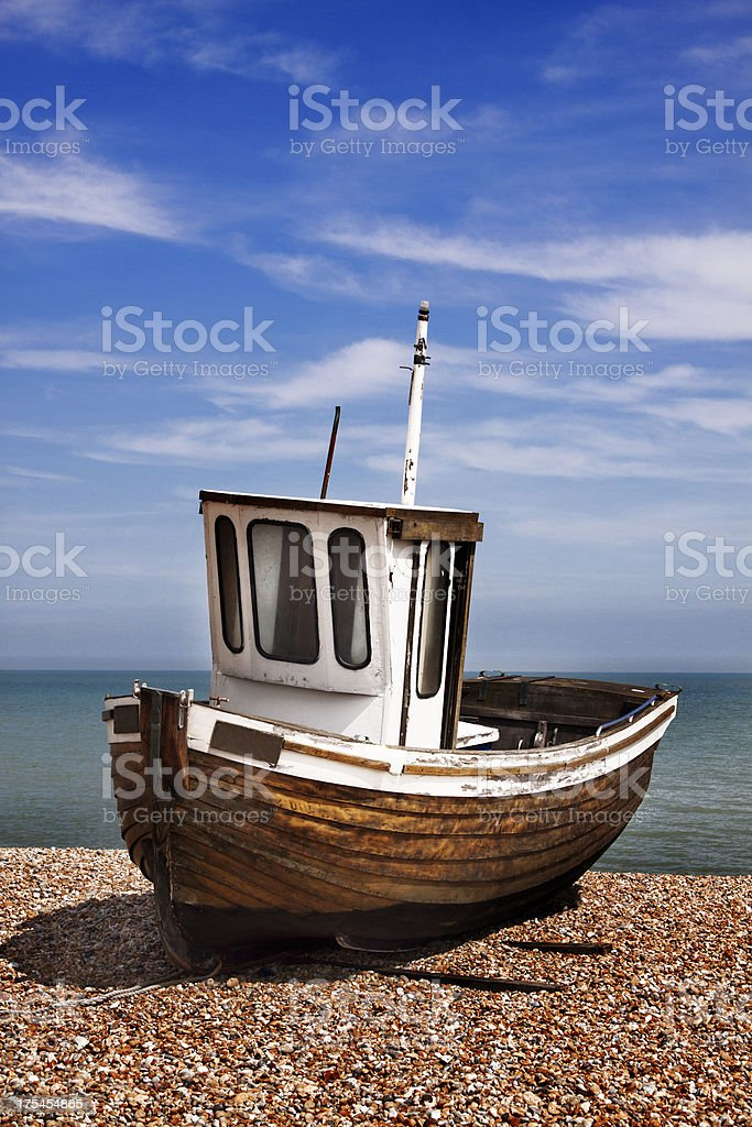 Tug Boat on Pebble Shore stock photo