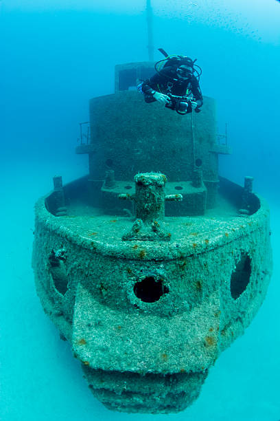 Tug Boat Rozi and diver stock photo