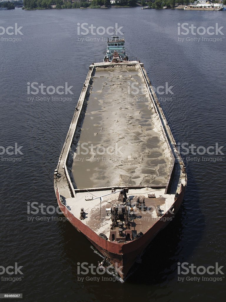 Tug boat with barge stock photo