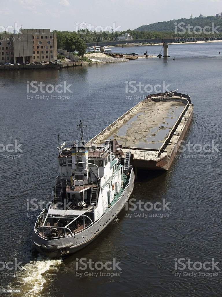 Tug boat with barge royalty-free stock photo