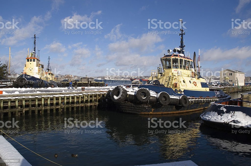 Tug boats covered in snow, Halifax harbour royalty-free stock photo
