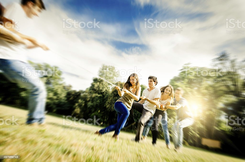 Tug of war game outside stock photo