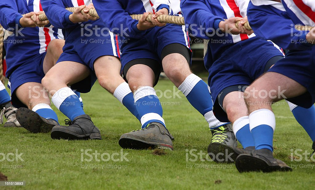 Tug of War Two teams compete against each other in the tug of war, a old traditional sport in Britain. Adult Stock Photo