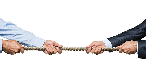 Tug of war Two businessmen pulling a rope in opposite directions isolated on white background pulling stock pictures, royalty-free photos & images