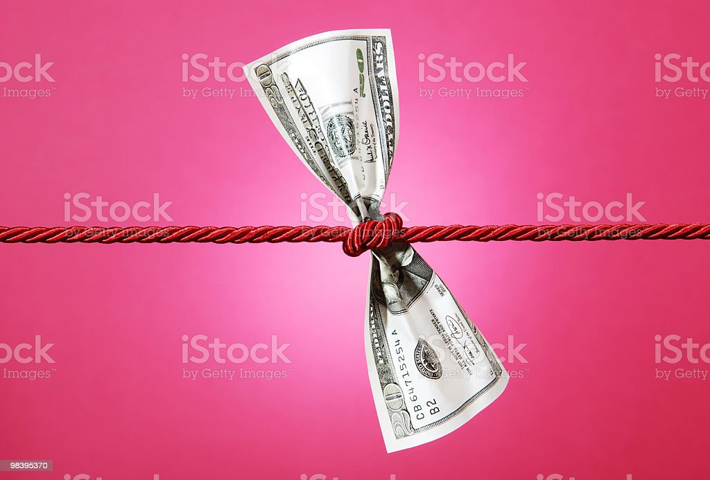 Tug of war with dollar royalty-free stock photo