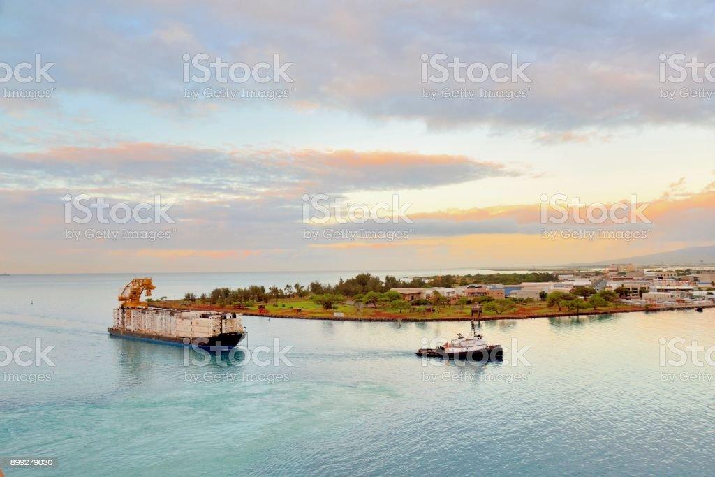 Tug Pulling Barge into Honolulu stock photo