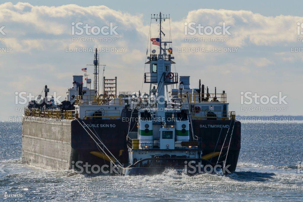 Tug pushing barge into Buzzards Bay stock photo