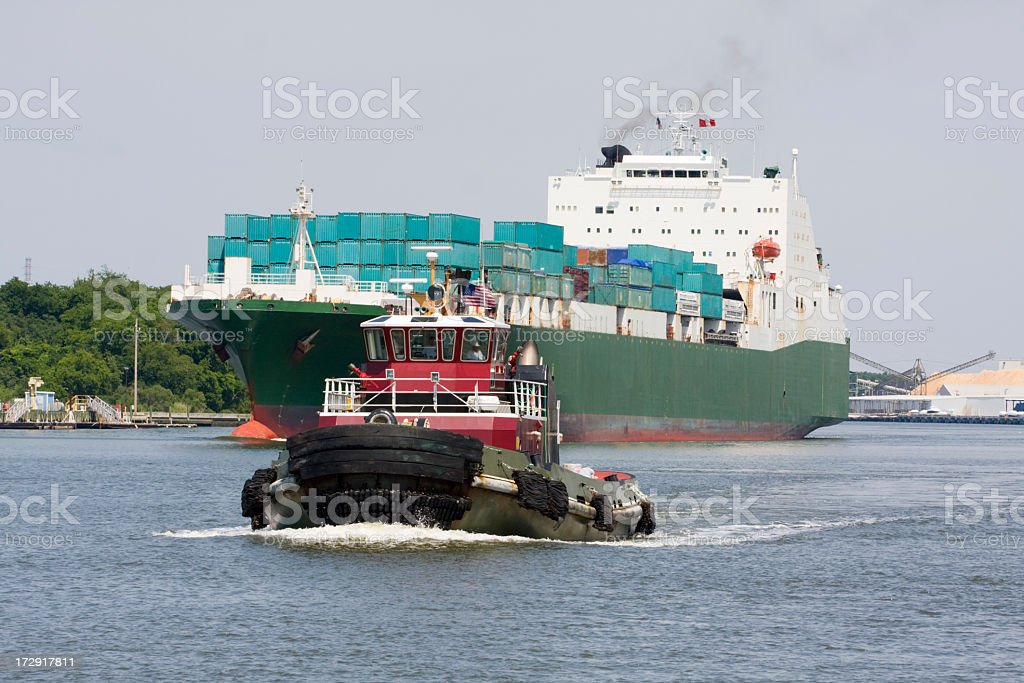 Tugboat and Cargo Ship on a river royalty-free stock photo