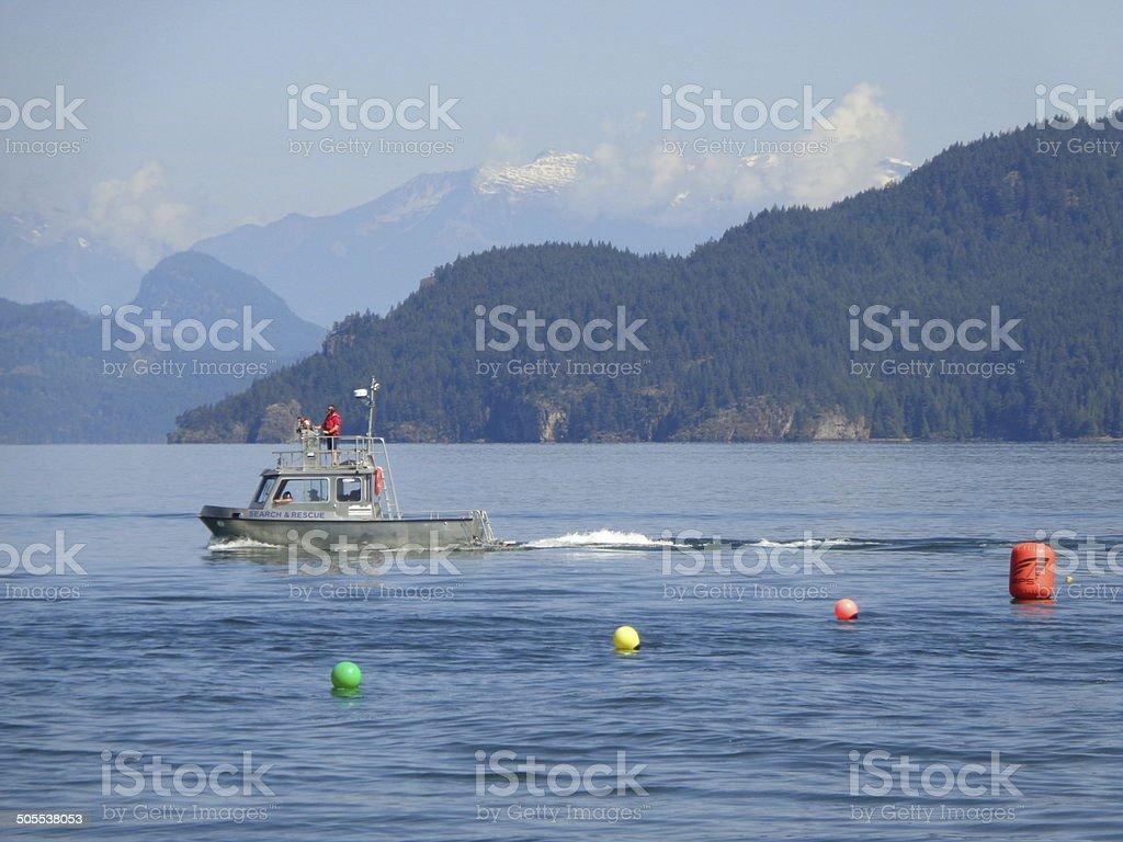 Tugboat and colorful buoys on B.C. Lake stock photo