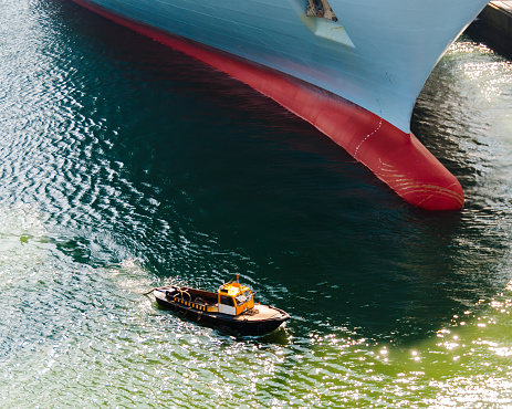 Tugboat and Container Ship – David and Goliath