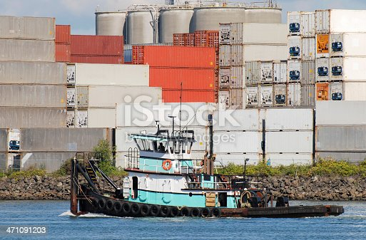 Tugboat and containers on industrial waterway