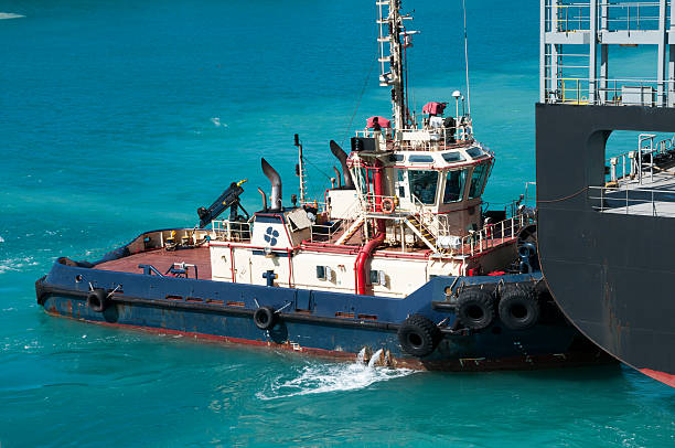 Tugboat assistance stock photo