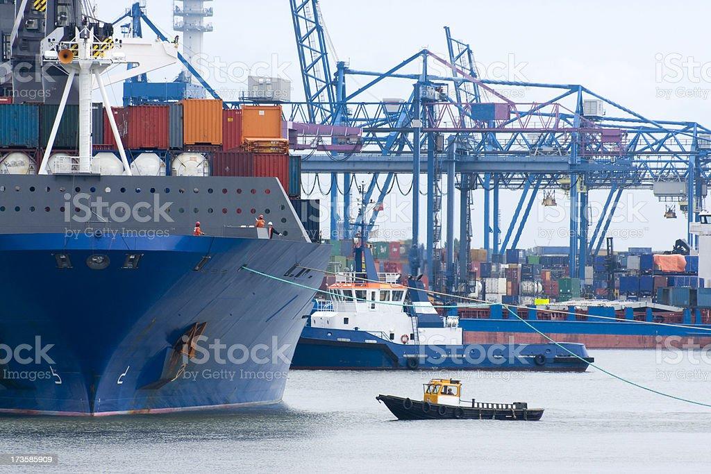 Tugboat at tanker royalty-free stock photo