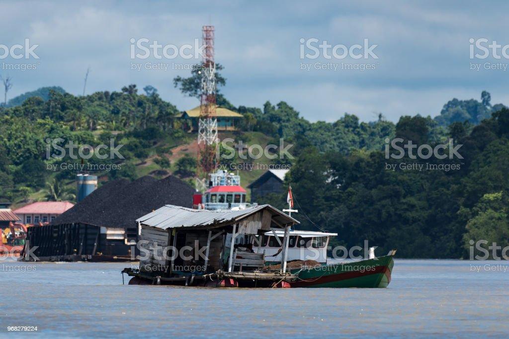 Tugboat for coal transportation in Berau, Kalimantan stock photo
