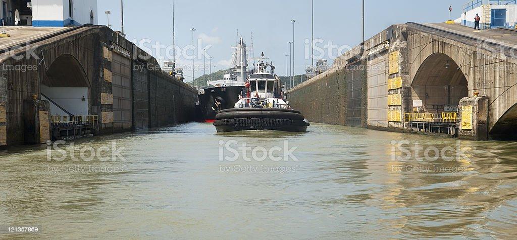 Tugboat in Panama Canal Lock stock photo