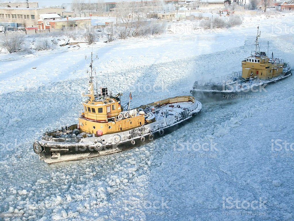 Tugboat in the Frosted channel stock photo