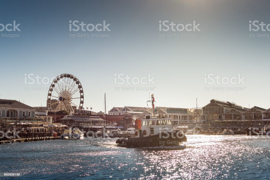 Tugboat leaves docks at Victoria & Alfred Waterfront - Cape Town stock photo