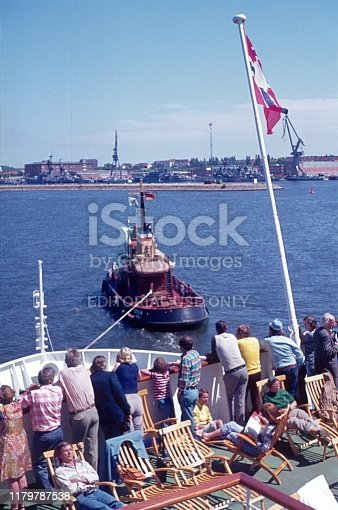 Oslo, Norway, 1968. Schlepper pulls a Baltic ferry to the port of Oslo. Also: passengers.