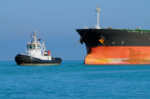 Industrial ship and tugboat