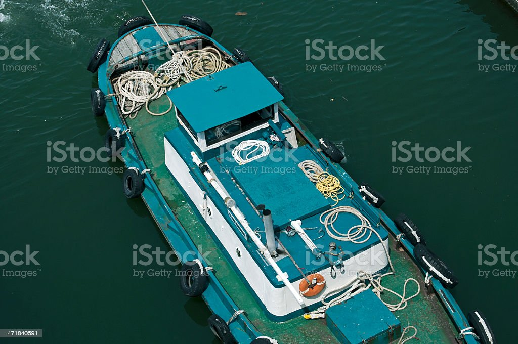 Tugboat pulling vessel through lock royalty-free stock photo