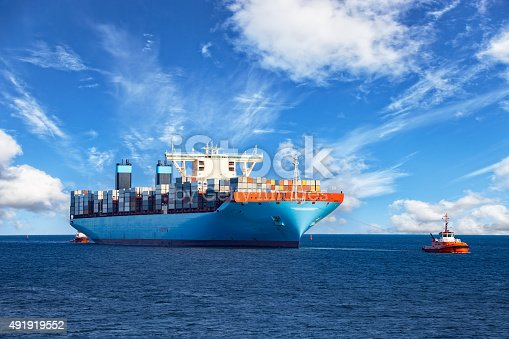 istock Tugboat towing container ship 491919552