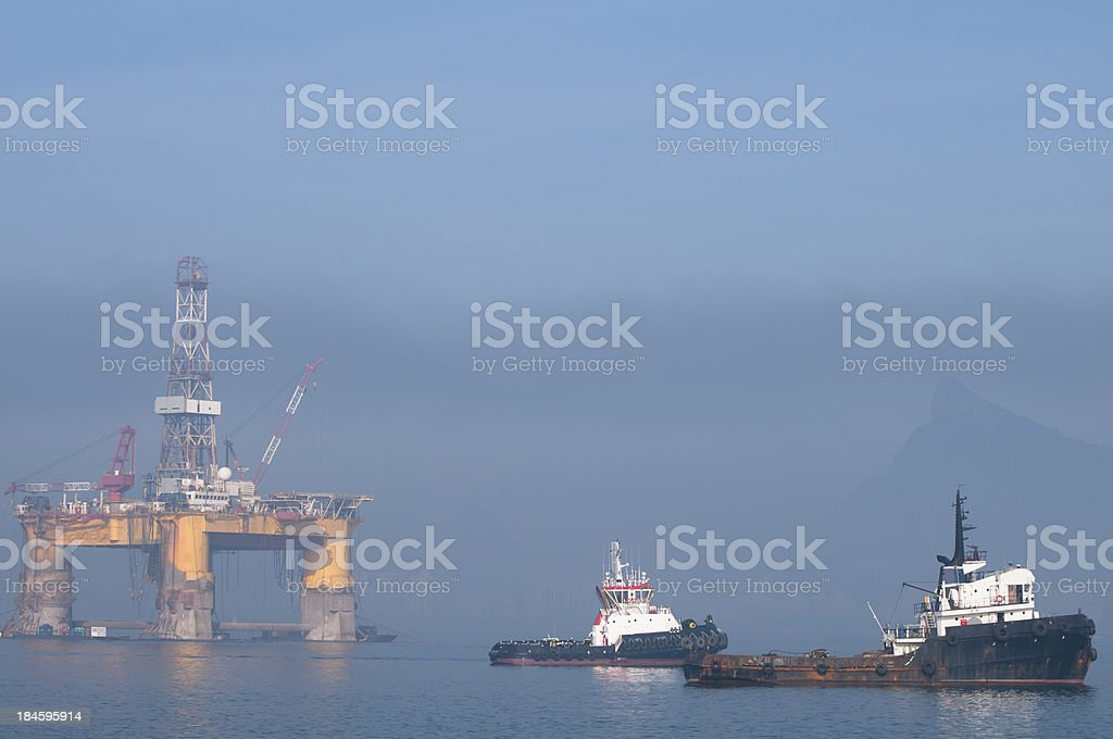 Tugboats and an oil platform royalty-free stock photo