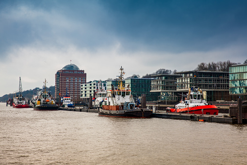 Tugboats docked at the Hamburg port on the banks of the Elbe river
