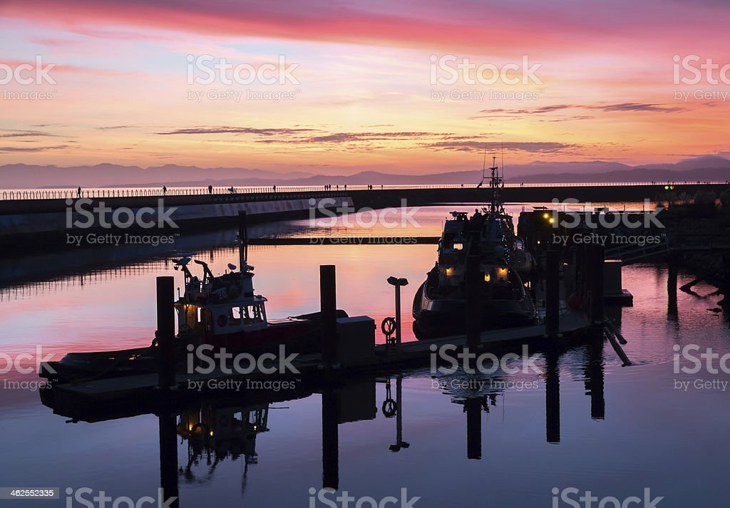 tugboats in sunset stock photo