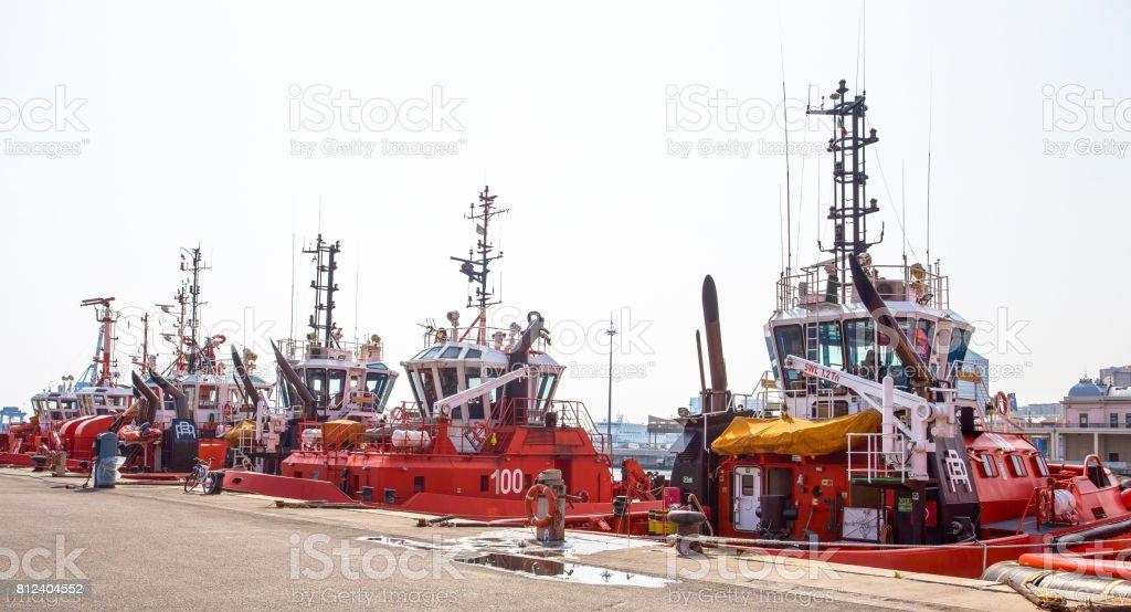 GENOA (Genova), ITALY APRIL 12, 2017 - Tugboats moored in the port of Genoa, Italy stock photo