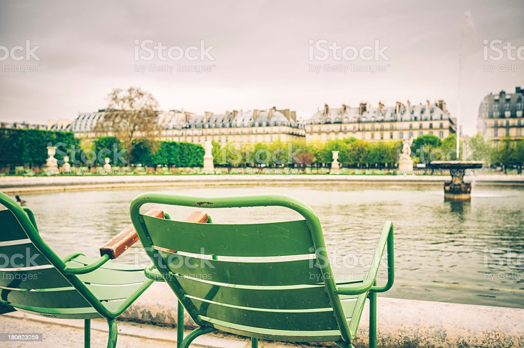 Tuileries Garden in Paris with green chairs stock photo