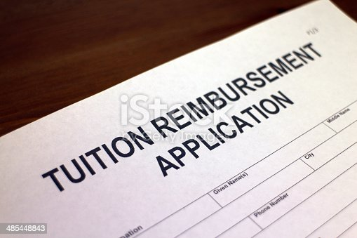 Someone filling out Tuition Reimbursement Application form
