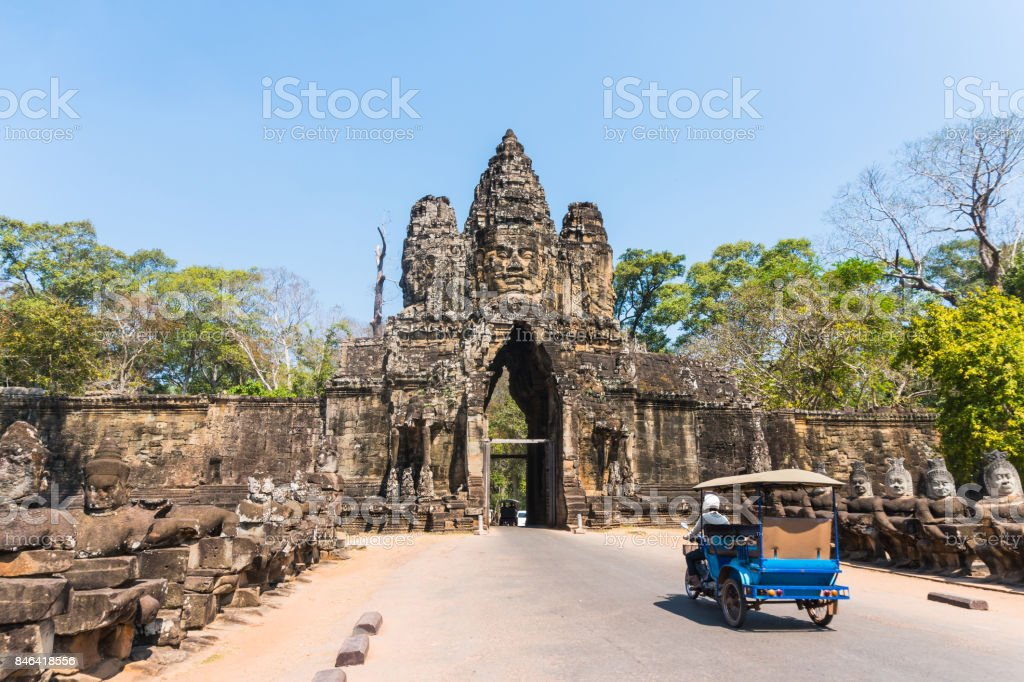 Tuk tuk and angkor thom gate in siem reap cambodia stock photo