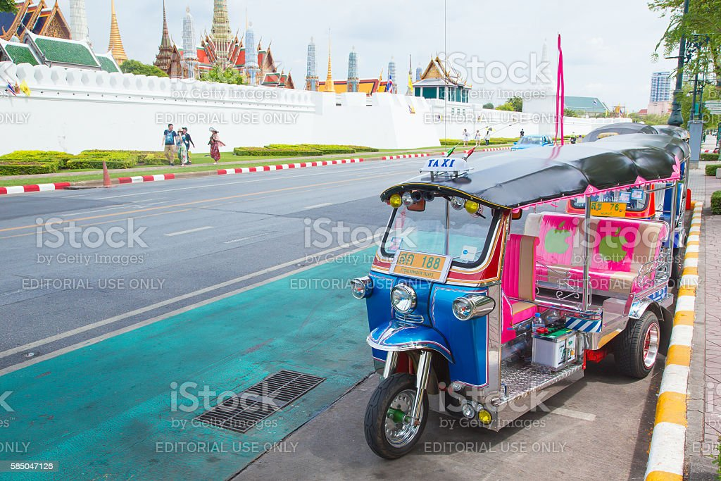 Tuk Tuk at Wat Phra Kaeo or Grand Palace. stock photo