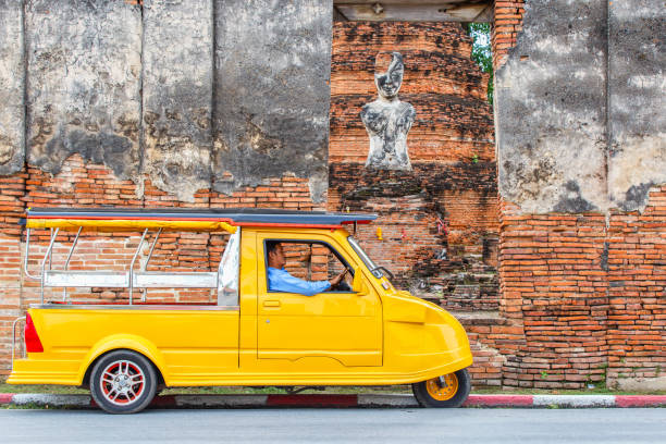 Tuk Tuk car tourist at parking outdoor at old temple background, Tuk Tuk is taxi car for travel around the Ayutthaya Province, Thailand stock photo