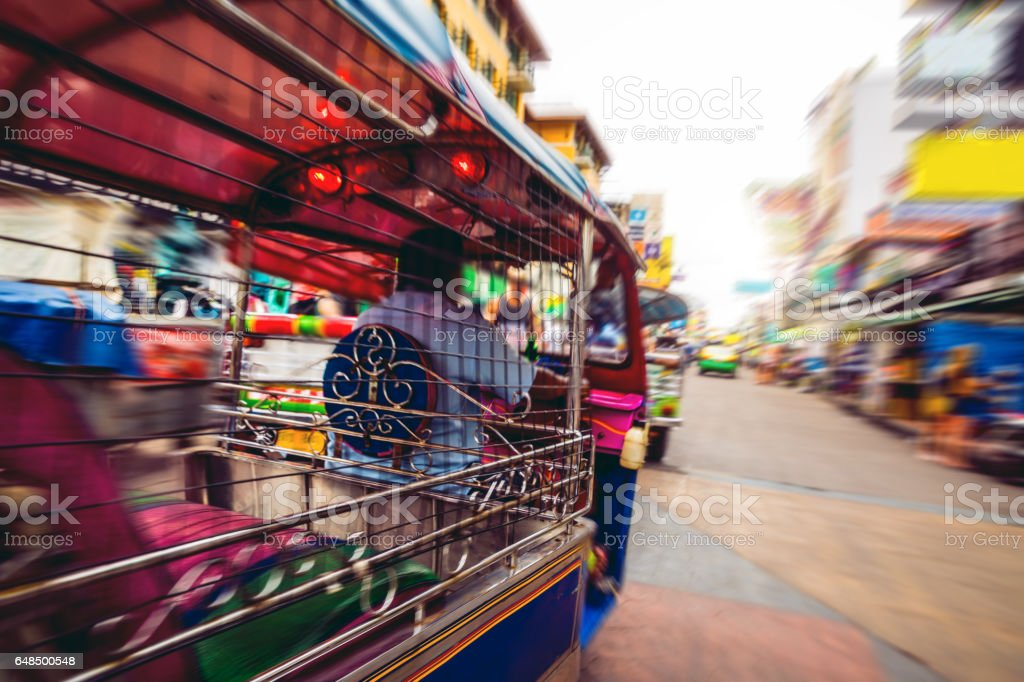 Tuk Tuk in Bangkok Khao San Road on a rush in the traffic stock photo