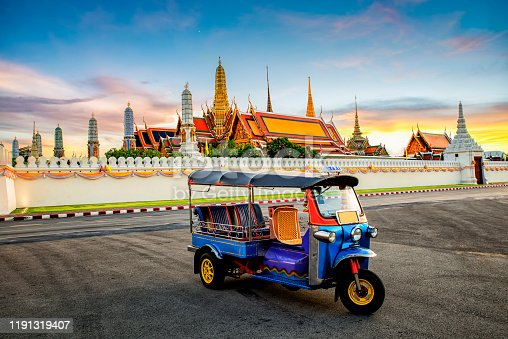 Wat Phra Kaew in Bangkok, Thailand and Tuk Tuk is on the road : Grand Palace and Wat Phra Kaew is among the best known of Thailand's landmarks