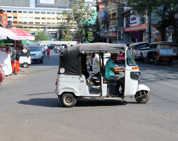 Tuk Tuk or Taxi tricycle on the road, Lifestyle of traffic in Phnom Penh. It is a three-wheeled motorized vehicle used as a taxi. Phnom Penh, Cambodia, Jan 30, 2019 : Tuk Tuk or Taxi tricycle on the road, Lifestyle of traffic in Phnom Penh. It is a three-wheeled motorized vehicle used as a taxi. three wheel motorcycle stock pictures, royalty-free photos & images