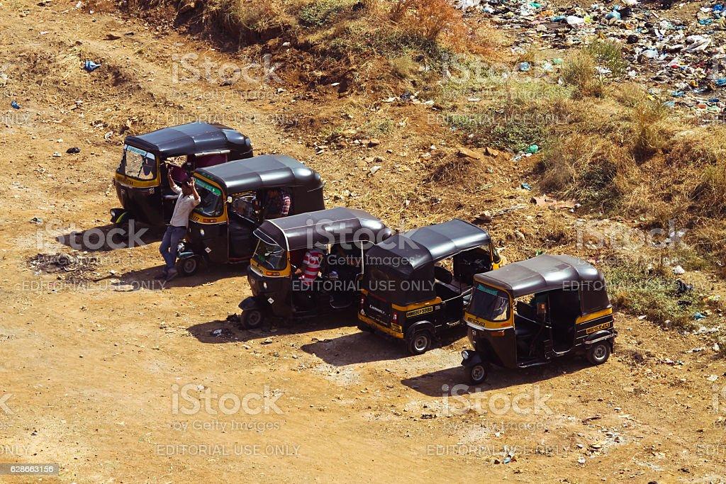 Tuk Tuk parked on the open field in Mumbai stock photo